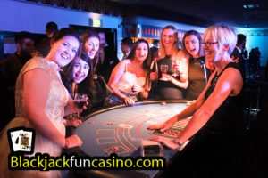 Croupier and guests at the blackjack table