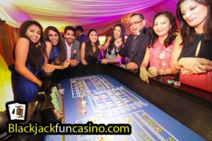 A group at the casino tables having great fun