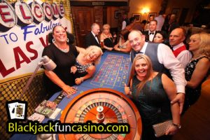 A group having great fun at the roulette table