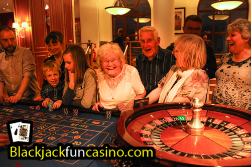 A group having lots of fun at the roulette table