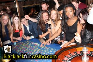 Lots of people having a great time at the roulette table