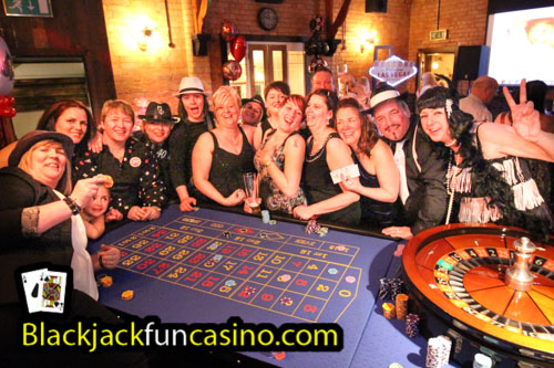 A group having lots of fun at the casino tables in Nottingham