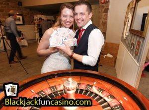 Bride and Groom at the roulette table.
